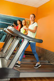 Group of girls running on the treadmill in gym Stock Photography