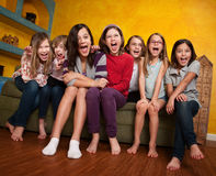 Group Of Girls Screaming. Group of happy barefoot girlfriends scream out Royalty Free Stock Image