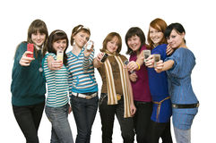 Group of the girls showing mobile phones Stock Images