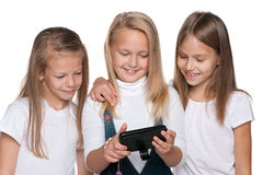 Group of girls with a smartphone Stock Images