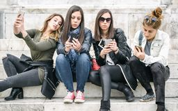 Group of girls with smartphones. Technology isolation and emotional depresion. Group of girls with smartphones. Technology cell phone isolation and emotional royalty free stock image