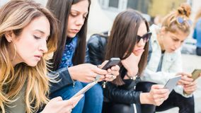 Group of girls with smartphones. Technology isolation and emotional depresion. Group of girls with smartphones. Technology cell phone isolation and emotional royalty free stock photo