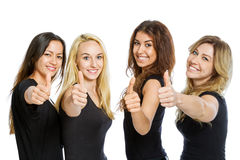 Group of girls standing with thumbs royalty free stock image