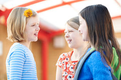 Group Of Girls Talking Outside School Building stock images