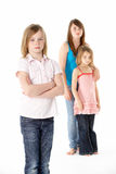 Group Of Girls Together In Studio Looking Unhappy Stock Photo