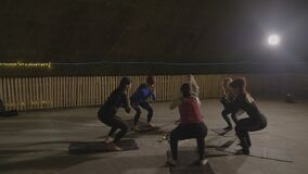 Group of girls toning their body muscles while doing yoga and breathing salty air in an european underground salt mine -. Group of girls toning their body stock video footage