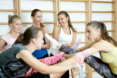Group of girls after training smiling and talking.  Stock Images
