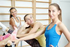 Group of girls after training smiling and talking.  Royalty Free Stock Image