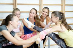 Group of girls after training smiling and talking.  Royalty Free Stock Photo
