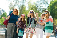 Group of girls walking through downtown - pointing royalty free stock photo