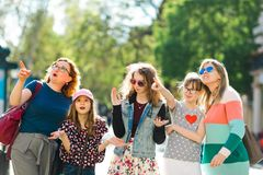 Group of girls walking through downtown - surprisingly pointing to interesting places royalty free stock photo