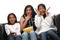 Group of girls watching TV. Three Pretty girls watching TV at home Stock Photos