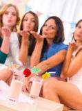 Group of girls. Young beautiful girls drink cocktails at home party Stock Photos