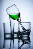 Group of glasse whit green water on blue background. And reflex Stock Photos