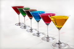 Group of glasses with colored beverages Royalty Free Stock Photography