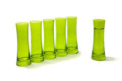 Group of glasses with one apart of them. Stock Image