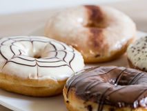 Group of glazed donuts on white background Stock Images