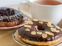 Group of glazed donuts on white background. Group of glazed and creamydonuts on white background Stock Image