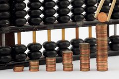 Group of gold coin graph form and abacus Stock Photo