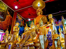 Group of gold painted Buddha statues. Royalty Free Stock Photos
