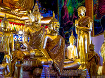 Group of gold painted Buddha statues In Thailand. Royalty Free Stock Images