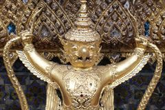 Golden Garuda statue stand around , the bronze symbol of Thai government, giant ancient gold eagle with crown sculpture. Group of golden Garuda statue stand royalty free stock image