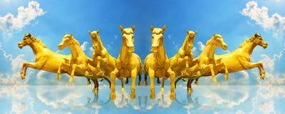 Group of golden horses running Stock Photo