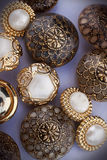 Group of golden vintage buttons. A group of golden vintage buttons. Haberdashery, creativity Stock Photos