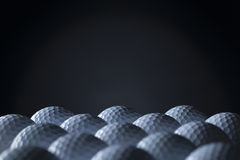 Group of golf balls isolated on black background. Royalty Free Stock Photo