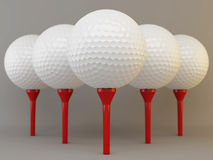 Group of golf  balls on tees Royalty Free Stock Photography