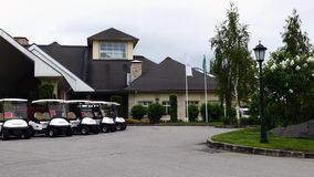 Group of golf cars in front of Aglalrov estate golf club. Royalty Free Stock Image