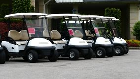 Group of golf cars in front of Aglalrov estate golf club. Royalty Free Stock Photo