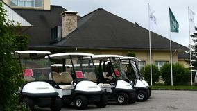 Group of golf cars in front of Aglalrov estate golf club. stock footage