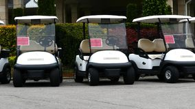Group of golf cars in front of Aglalrov estate golf club. stock video