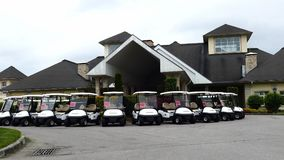 Group of golf cars in front of Aglalrov estate golf club. Royalty Free Stock Photos