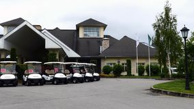 Group of golf cars in front of Aglalrov estate golf club. Stock Photography