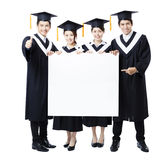 Group of graduate students presenting empty banner Royalty Free Stock Photos