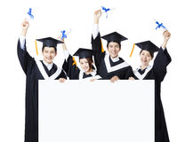 Group of graduate students presenting empty banner Stock Images