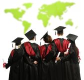Group of graduated students against world map Stock Photography