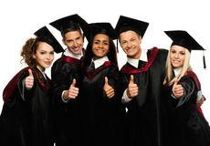 Group of graduated young students. Multi ethnic group of graduated young students isolated on white Royalty Free Stock Photos