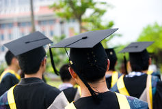 Group of graduates. Shot of graduation caps during commencement Stock Image
