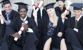 A group of graduates celebrating Stock Photo