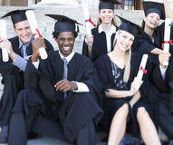 A group of graduates celebrating Stock Image
