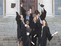 A group of graduates celebrating Stock Photos