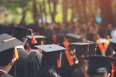 Group of Graduates during commencement. Concept education congratulation in University. Graduation Ceremony royalty free stock images