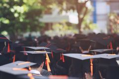 Group of Graduates during commencement. Concept education congratulation in University. Graduation Ceremony stock photo