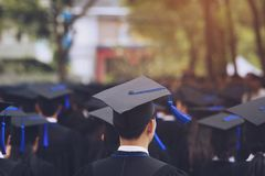 Group of Graduates during commencement. Concept education congratulation in University. Graduation Ceremony royalty free stock image