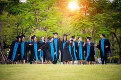 Graduation. Group of graduates fill happy and relaxing in graduation day Stock Image