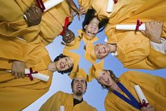 Group Of Graduates Forming Huddle Royalty Free Stock Photography