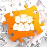 Group of Graduates Icon on Orange Puzzle. Stock Photography